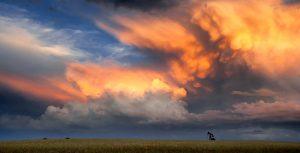 Storm Cloud and oil derrick